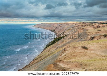 The Grand Sable Dunes rise high above Lake Superior near Grand Marais in Upper Peninsula Michigan's Pictured Rocks National Lakeshore. - stock photo