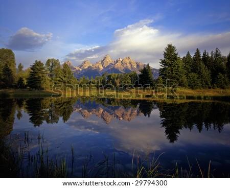 The Grand Teton Mountain Range at Schwabackers Landing in Grand Teton National Park, located in Wyoming. - stock photo