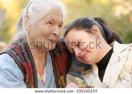 The grandmother with the grand daughter. A photo on outdoors - stock photo