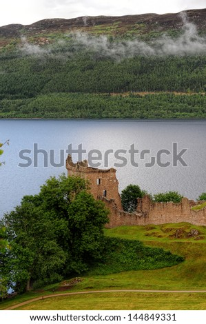 The Grant tower of the Urquhart Castle.The castle is situated on a headland overlooking Loch Ness in the highlands of Scotland - stock photo