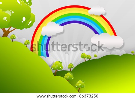 The grass with a blue sky and Rainbow - stock photo