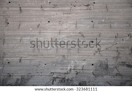 The gray concrete wall with armature