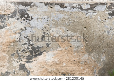 The gray concrete wall with crumbling plaster. textural composition - stock photo