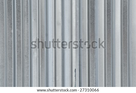 The gray metal ribbed surface - stock photo