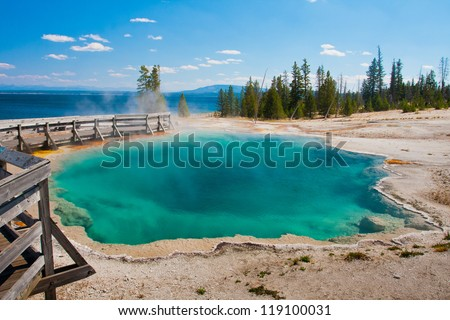 The great blue pool in Yellowstone National Park - stock photo