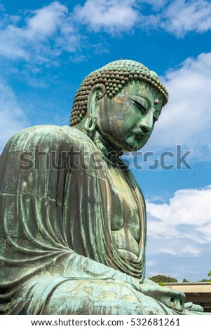 The Great Buddha in Kamakura Japan.  Located in Kamakura, Kanagawa Prefecture Japan.There are pigeon to Buddha's head.