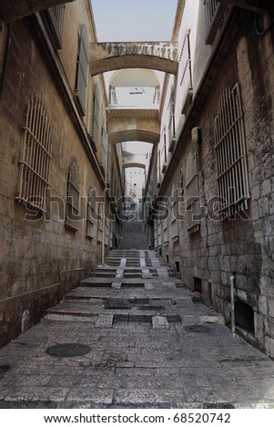 The great city of Jerusalem. Narrow and empty street in Christian quarter of the Old city - stock photo