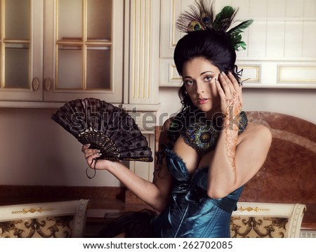 The great fashionable lady with a fan - stock photo