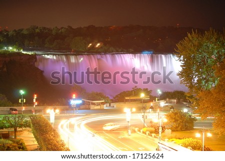 The Great Niagara Falls at night, lit up by colored lights in Canada 1 - stock photo