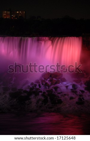 The Great Niagara Falls at night, lit up by colored lights in Canada 9 - stock photo