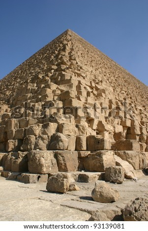 The great pyramid at Giza, Egypt was once covered with white plaster that is long gone revealing the architecture underneath. - stock photo