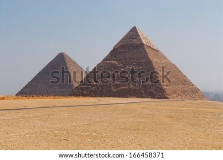 The Great Pyramid of Giza against blue sky. Giza, Egypt. - stock photo