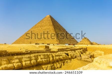 The Great Pyramid of Giza and smaller Pyramid of Henutsen (G1C) - stock photo