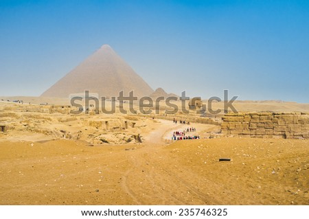 The Great Pyramid of Giza (Pyramid of Khufu or the Pyramid of Cheops) is the oldest and largest of the three pyramids in the Giza Necropolis, Egypt. - stock photo