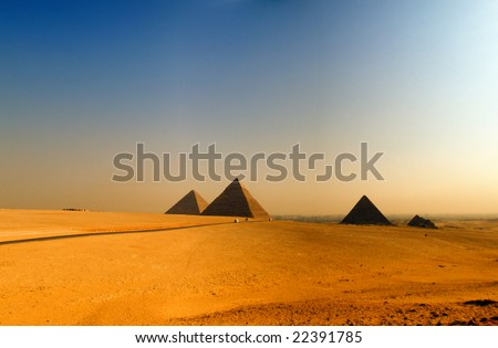 the great pyramids of giza in Egypt with cairo in the background - stock photo