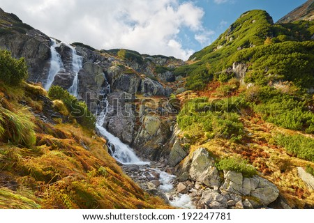 The Great Siklawa Waterfall (70 m high) on Roztoka Stream. The High Tatra Mountains, Carpathians. Valley of Five Polish Ponds. Amazing nature reserve in Poland. - stock photo