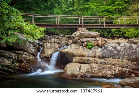 The great smokey mountains national park, bridge with waterfall , hiking trail - stock photo