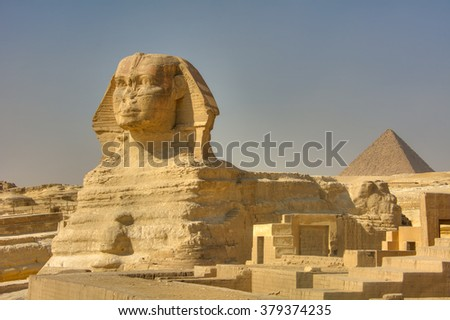 The Great Sphinx of Giza. Monumental limestone statue of a reclining sphinx with a lion's body and a human head (believed to represent Pharaoh Khephren), Giza, Egypt - stock photo