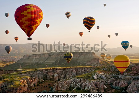 The great tourist attraction of Cappadocia - balloon flight. Cappadocia is known around the world as one of the best places to fly with hot air balloons. Goreme, Cappadocia, Turkey - stock photo