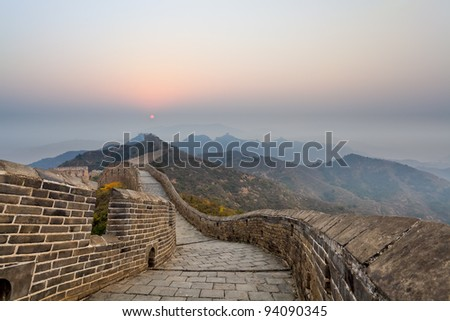 the great wall in ridge mountains at sunrise - stock photo