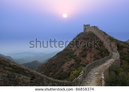 the great wall of china at morning in autumn - stock photo