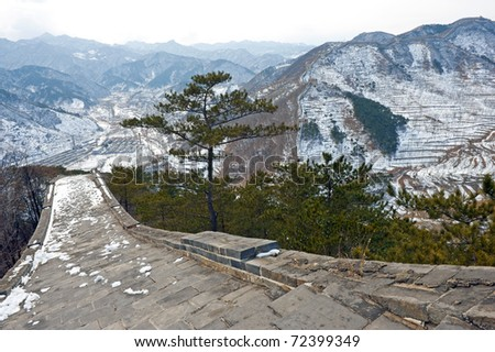 The Great Wall of China in snow - stock photo