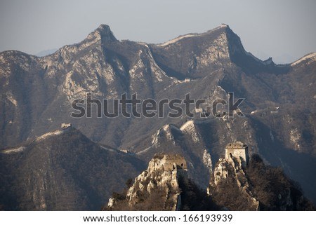 The Great Wall of China (Jiangkou) under the sunrise in winter. - stock photo