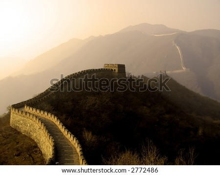 The Great Wall of China (Mu Tian Yu) under a setting sun. February 2007 - stock photo