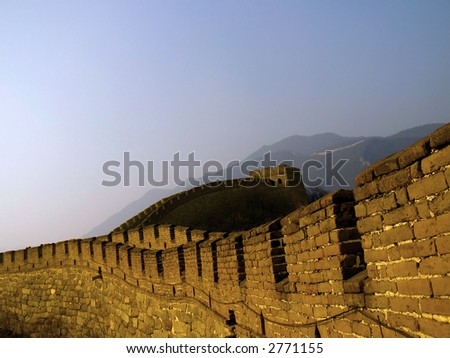 The Great Wall of China (Mu Tian Yu) under a setting sun. February 2007, Chinese New Year. - stock photo