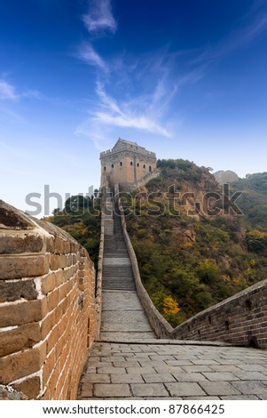 the great wall of china with blue sky - stock photo