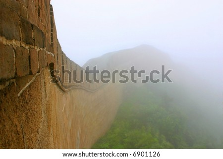 The Great Wall receding into fog - stock photo