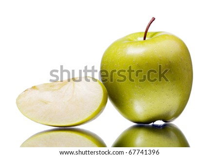 The green apple with the cut off segment, is isolated on the white