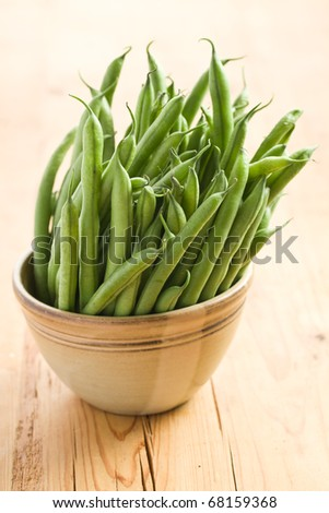 the green bean pods in brown bowl - stock photo