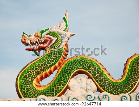The Green dragon status on sky background - stock photo