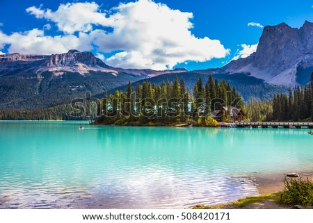 The green lake surrounded by forest. Magic Emerald Lake in Yoho National Park, Rocky Mountains