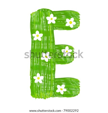 The green letters E drawn by paints with white blossom - stock photo