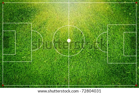 the green soccer field is in a miniature - stock photo
