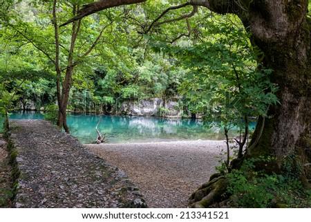The green waters of Voidomatis river that flows through Epirus region, Greece. - stock photo