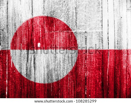 The Greenland flag painted on wooden pad - stock photo