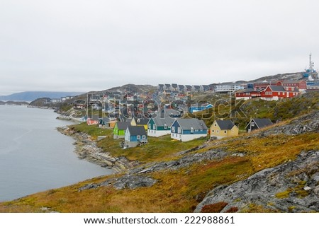 The grey skies and colorful housing of Nuuk, capital city of Greenland - stock photo