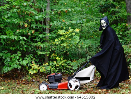 The grim Reaper mowing the lawn as part of the Honeydew list before preparing to harvest his crops on Halloween with room for your text - stock photo