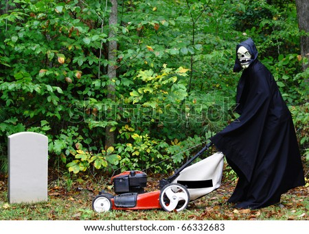 The Grim Reaper mowing the lawn of the cemetery as part of his chores before he can go out for the night with room for your text. - stock photo