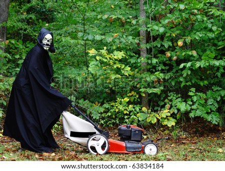 The Grim Reaper performing the last task on the Honeydew list of mowing the lawn on halloween before he can go harvest his crops with room for your text. - stock photo