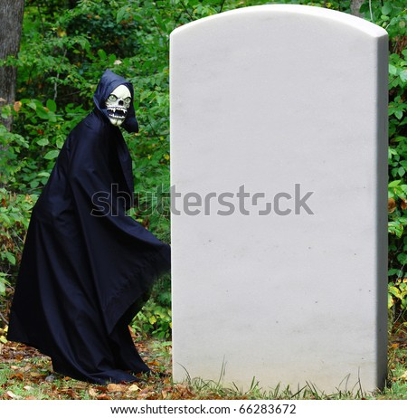 The Grim Reaper preparing to go behind a large tombstone for access to his secret entrance to the underworld with room for your text. - stock photo