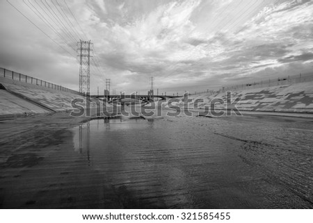 The gritty Los Angeles river in black and white.   - stock photo