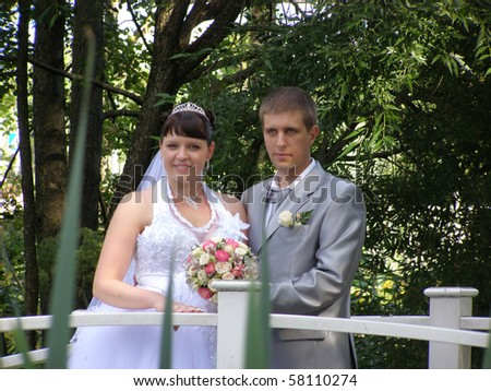 The groom and the bride in a garden