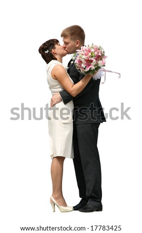 The groom and the bride kiss, are isolated on a white background - stock photo