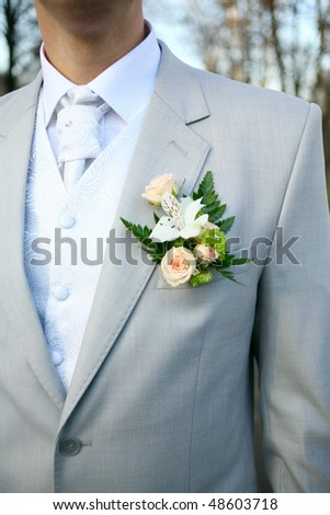 The groom at a wedding ceremony. Boutonniere for jacket - stock photo