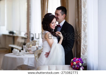 The groom kisses the bride in her head - stock photo