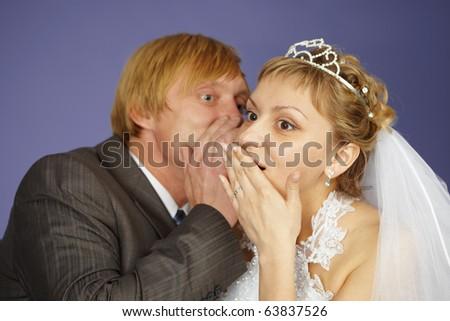 The groom tells the bride amazing news - stock photo